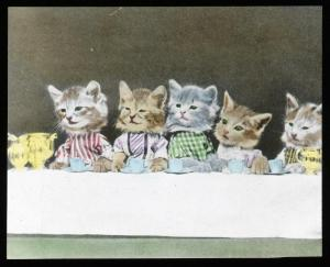 Lantern slide scan, kittens sitting at dinner table.