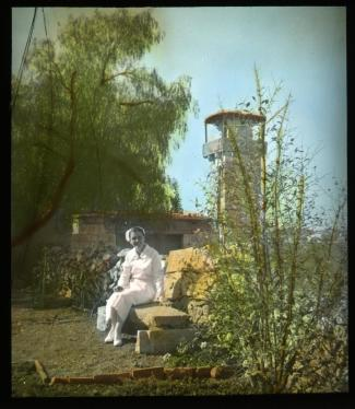 Lantern slide scan, woman on a bench.