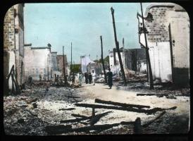 Lantern slide scan of main street in Kiating after being bombed.