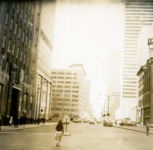 Photograph of a skyscraper-lined street in Montreal circa 1960