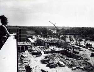 Photograph of student overlooking construction of the Physics Building circa 1965