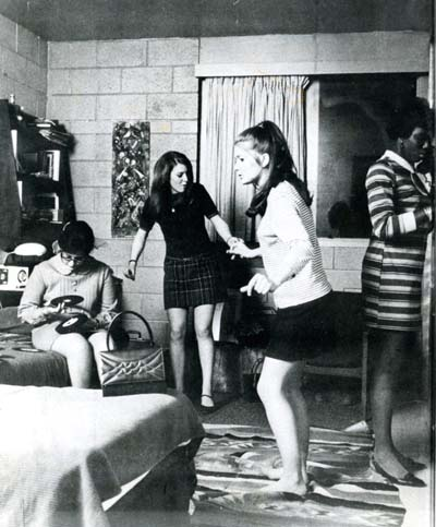 Photographs of women dancing to records in residence room circa 1960