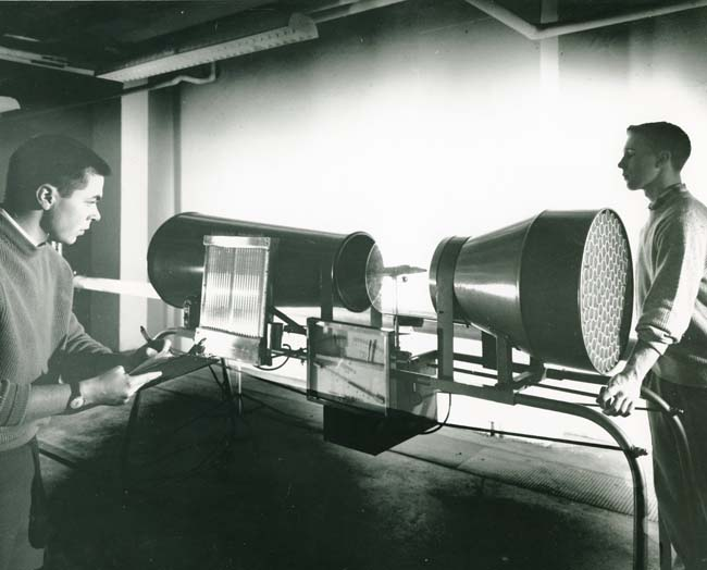 Engineering students demonstrate the use of the Wind Tunnel for detecting flutter in aircraft wings and tail assemblies circa 1958