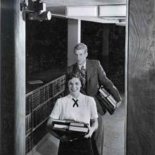 Students Harry MacDonnell and Marilyn Mansfield leaving the Library, January 1957