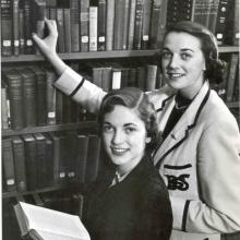 Christine Sutherland and Marilyn Mansfield in stacks at Carleton College Library, 1958